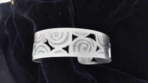 Sterling cuff bracelet with pierced and acid etched swirls - $98